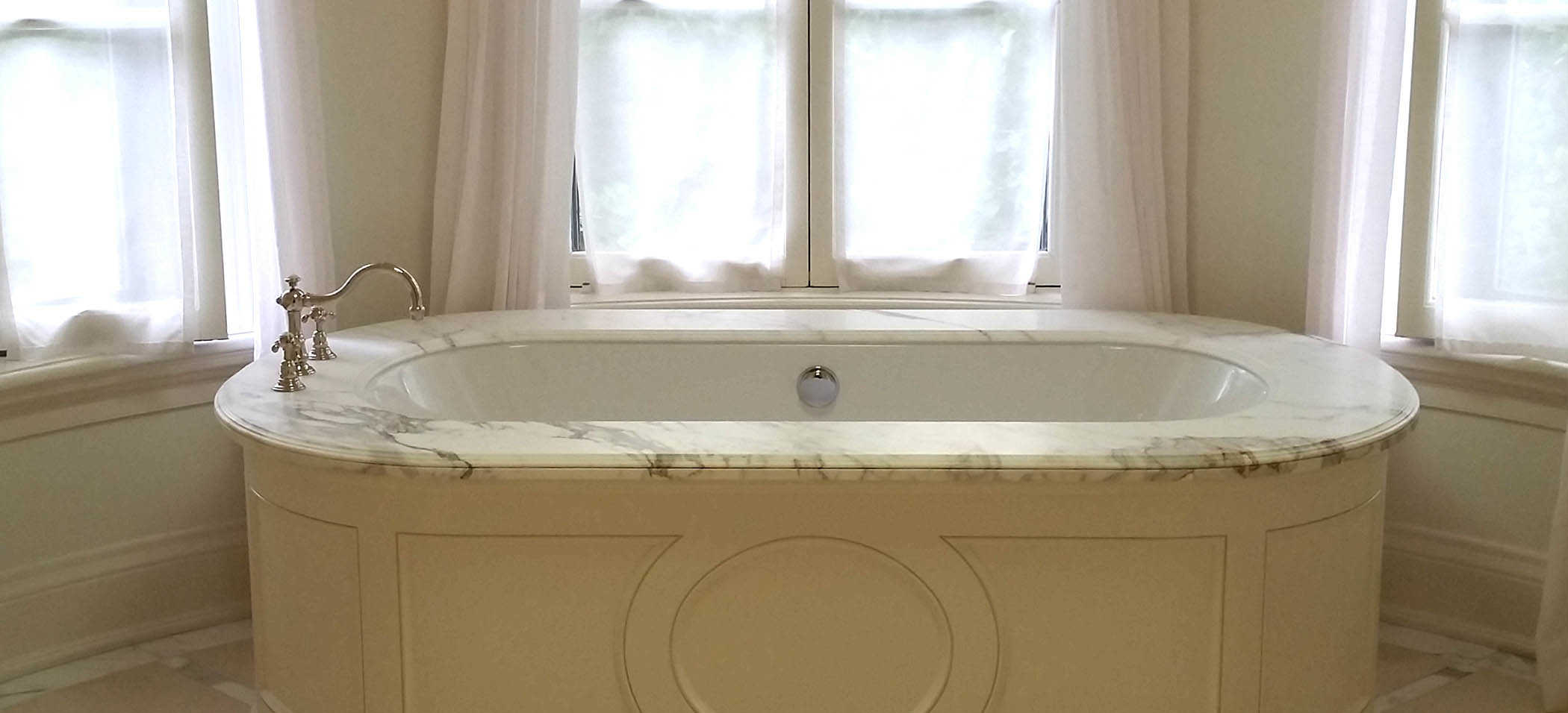 Honed marble tub surround.