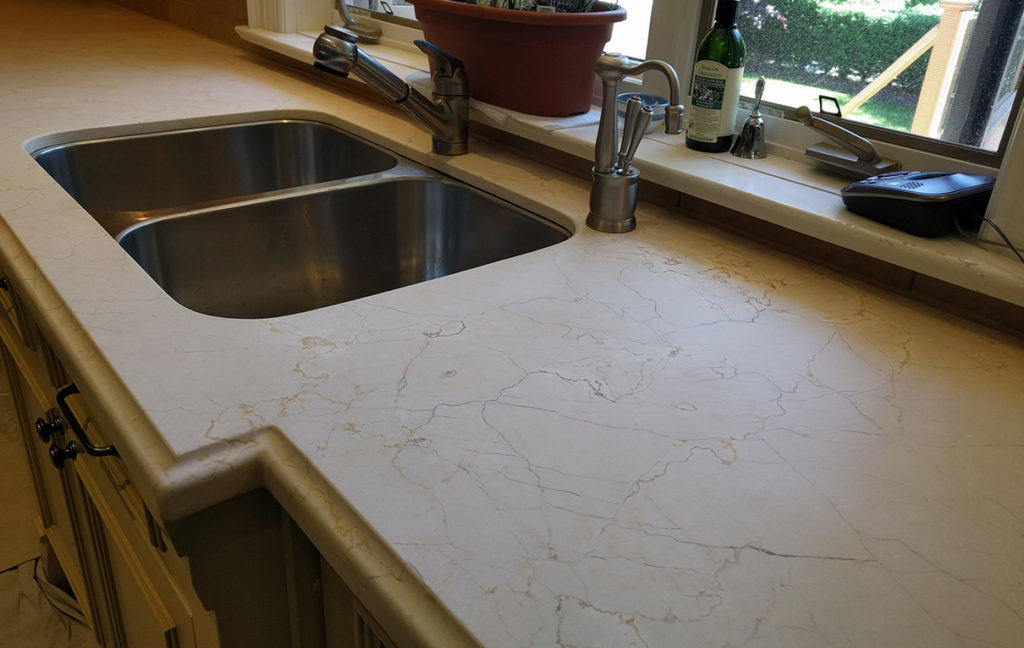 Resurfaced crema marfil counter to a honed finish.